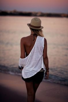 I love the fedora, flow-y shirt, and denim shorts combo!