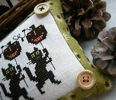 Cross stitch pattern Sweeping Cobwebs by Prairie Schooler at thecottageneedle.com, $9.00