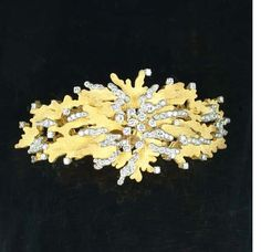 A gold and diamond bracelet, by Andrew Grima,