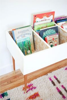 Keep Kids Organized and Curious With This DIY Book Bin Katie Loves …this functional and fashionable book bin for a kids bedroom or playroom. A set of mid century modern table legs and beautiful wallpaper make this version stand out. Toy Rooms, Kid Spaces, Small Spaces, Kids Decor, Girl Room, Diy For Kids, Ikea For Kids, Kids Playing, Diy Projects