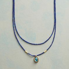 ASTONISHMENT NECKLACE -- Ananda Khalsa's blue topaz flashes hues amid strands of tiny lapis beads. Matte 22kt gold beads and bezel