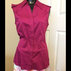 Sleeveless fuchsia button front top Cute button front top. Buttons are hidden under front placket. Cute shoulder details. Worn once. 97% cotton 3% spandex. Bundle with the skirt or another item for 20% off total. Tops