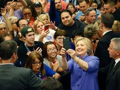 PHOTO: Hillary Clinton takes a selfie with supporters at a rally at California State University, San Bernardino, in San Bernardino, California, June 3, 2016.