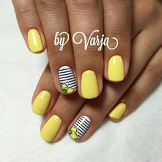 Yelloe nails with lemons and stripes