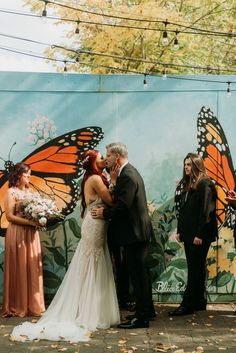 An intimate wedding ceremony complete with loved ones and a butterfly mural backdrop. | Image by Meagan Lawler Photography Intimate Wedding Ceremony, Garden Wedding Inspiration, Brunch Wedding, Pastry Shop, Friend Wedding, Wedding Blog, Backdrops, The Incredibles, Gallery