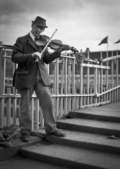 Image by Gerry Smith from Dublin Inner City, 1980's.  Busker.