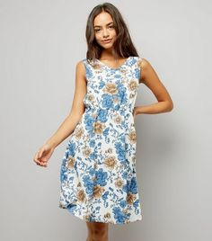 """Mela. Update your everyday wardrobe in this floral print dress. Pair with heels for a chic finish.- Rounded neckline- All over floral print design- Sleeveless design- Gathered waist- Mini length- Arielle is 5'9""""/175cm and wears UK 10/EU 38/US 6"""