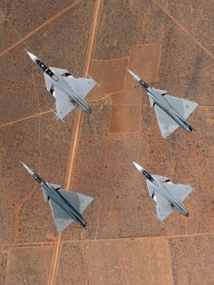 Saab JAS 39 Gripen flanked by a pair of Atlas Cheetahs