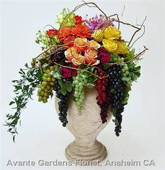 Tuscan Flower Arrangement would look great at our local winery for a wedding