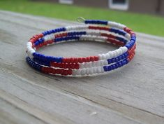 This bracelet is inspired by the 4th of July. It is a 3 coil memory wire bracelet made with red, white, and blue glass seed beads on durable