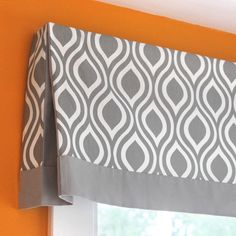 Learn how to make a no sew valance that has pleats at the corners and an accent band at the bottom. This simple design will go with many décor styles.