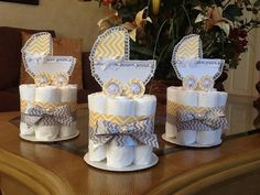 These beautiful mini diaper cakes make cute and elegant baby shower centerpieces. Each made with 7 diapers size 2 Pampers Swaddlers brand,