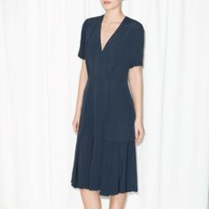 & Other Stories Dark Blue Wrap Dress & OTHER STORIES Cut from lightweight viscose for a feminine silhouette, this versatile wrap dress has a flounce skirt, a plunging V-neck and short sleeves. Inseam pockets & Other Stories Dresses