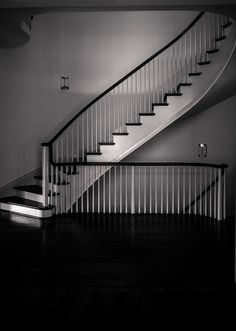 Elegant double curved stair with wood baluster system in Atlanta, GA.