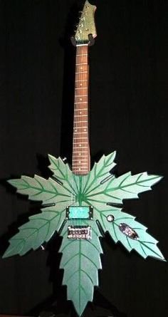 Super Custom Marijuana Guitar  HEAVY METAL T-SHIRTS and METALHEAD COMMUNITY BLOG. The World's No:1 Online Heavy Metal T-Shirt Store & Metal Music Blog. Check out our Metalhead Clothing and Apparel Store, Satanic Fashion and Black Metal T-Shirt Stores; https://heavymetaltshirts.net/