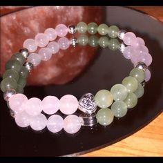 Chakra bracelet Rose Quartz is THE Love stone. It is famous for drawing love to you and being one of the most important crystals for your heart and heart chakra, and it has it's reputation for a reason.  Draw luck to you because this is the stone that is infamous for it. Green Aventurine is a stone of positivity and prosperity. It is known to balance your heart chakra and protect it.   Adorned with a simple Celtic heart knot and sterling silver 6mm beads Simply Irish Reiki Jewelry Bracelets