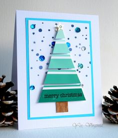 handmade Christmas card ... separated strips triangle tree made from paint chip ... luv the sequins and the bright mod look ...