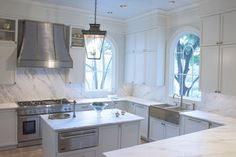 Very white, All White kitchen.  The veining in the marble works well with the finishes on the appliances and the range hood