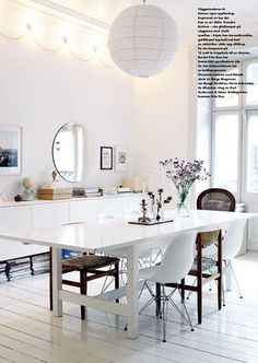 Big white dining table & white + wooden chairs & magazines on the floor. by Iro {Ivy style33}, via Flickr