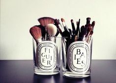 Love the idea of reusing candle glasses as brush holders. wonder what other Ideas I can find for all my empty candle glasses! Diptyque Candles, Old Candles, Candle Jars, Candle Containers, Candle Holders, Glass Candle, Rangement Makeup, Diy Rangement, Make Up Storage