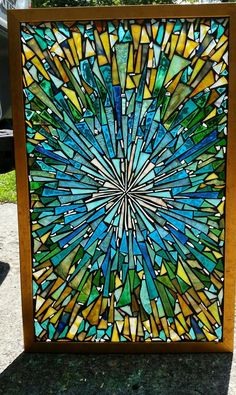 Stained glass mosaic panel by Chanda Froehle.