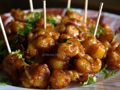 Recipe for popular Gobi Manchurian dry made from Cauliflower florets mixed with flour batter, deep fried and then mixed with Chinese spicy ingredients like Soy Sauce, Ginger, Garlic, Onions.