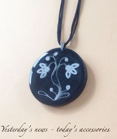 Quilled paper pendant coated with epoxy resin by Yesterday's news - today's accessories