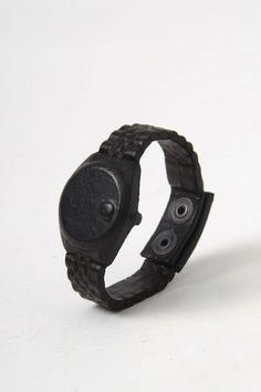 Natalia Brilli Nolex black leather covered watch bracelet featuring a Rolex shape.