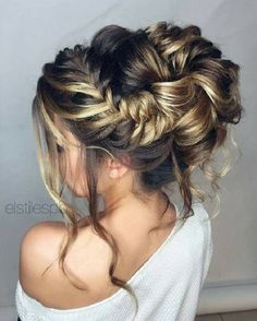 Unique messy updo wedding hair with braids | fabmood.com