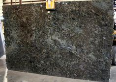 Laboradite granite images and photos for stone countertops, slabs, vanity tops, flooring and tile showers. Granite Tops, Granite Slab, Stone Countertops, Travertine, Remodeling Ideas, Surface Design, Daydream, Cool Kitchens, Labradorite