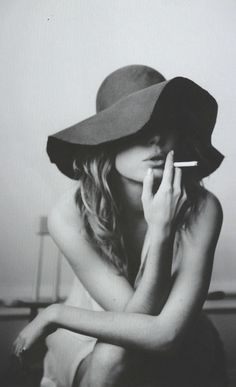 black and white model in hat (I don't smoke)