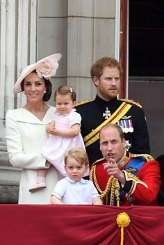 Kate Middleton, Princess Charlotte, Prince George, Prince Harry and Prince William wave from the balcony at Buckingham Palace.