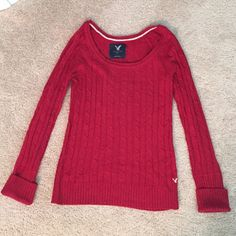 AE Cable-Knit Sweater Red cable knit sweater from American Eagle.            Scoop neck.                                                                   Perfect length.                                                            Warm! American Eagle Outfitters Sweaters