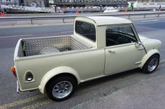 This is an interesting little car (pickup). Minimac is on the back but I cannot find any reference to this variation of the mini so I am assuming that it is a mini pickup.