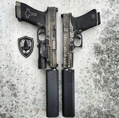 Glock - gonna translate the norse runes on the side.. google norse runes, if i dont.. the gun on the right