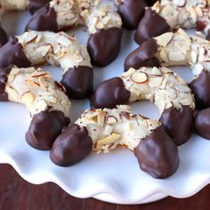 Mandelhörnchen, or Almond Horns, are German marzipan-based cookies dipped in chocolate that are absolutely irresistible!