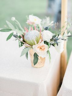 Protea centerpieces: http://www.stylemepretty.com/2016/06/30/this-couple-gave-guests-the-donut-bar-of-our-dreams/ | Photography: Honey Honey Photography - http://www.hoooney.com/