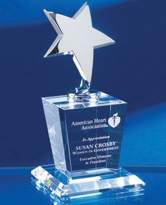 """The Silver Star Crystal Award measures 8"""" in height and showcases a combination of optical crystal and highly polished silver metal. The crystal base is deep etched by an expert carver with your custom engraving and logo. Crystal star theme awards are the perfect choice for rewarding stellar performance. This crystal star trophy ships in a premium quality presentation box. Star awards capture the right mood and make great corporate gifts at retreats and award ceremonies."""