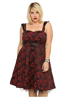 <p>Red and black dress with an allover brocade design, ruffled shoulder straps, lace-up detailing and tulle lining.</p>  <ul> <li>60% cotton; 37% polyester; 3% elastic</li> <li>Wash cold; line dry</li> <li>Imported</li> </ul>