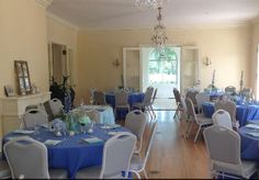 Any hue of blue looks great inside the mansion. The chandeliers in the dining rooms really set the mood for your reception.