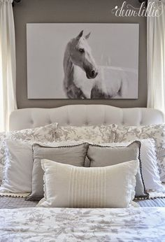 This black and white oversized horse photograph from @homegoods adds a dramatic touch above the bed. (sponsored pin)