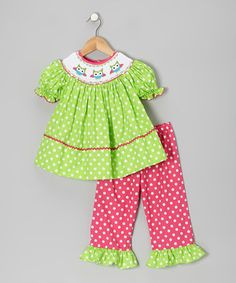 From holidays to tea parties, this smocked and ruffled outfit is perfect for when little girls want to get dolled up. Buttons in back make this top easy to slip on, while an elastic waistband keeps the pants comfy and easy to move in. Charming smocking creates and heirloom quality that will always transcend the trends.
