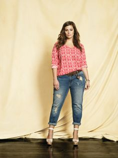 Plus size supermodel Ashley Graham wearing a long sleeve v-neck blouse with BUFFALO boyfriend jeans and a braided belt. Available at Addition Elle, your plus size destination. # plussize