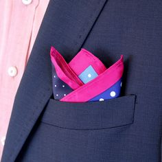 The Icebreaker - This Fourway Pocket Square gives you a traditional polka dot design but enough to break the ice with a deep magenta border and quadrants of blue, violet and black.