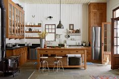 This handsome farmhouse cook space in New York's Hudson Valley was once a horse stable. The oak built-ins are made from a 150-year-old white oak tree that fell on the property, giving new meaning to locally made goods.