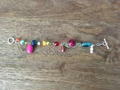 Unique, pretty, hand-made charm-style bracelet by TinyShopOfStuff on Etsy