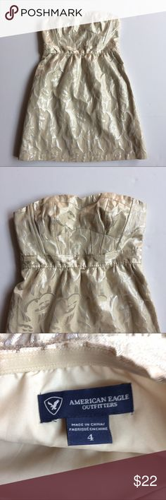 AE Strapless Metallic Dress Champagne colored strapless dress with sweetheart neckline and silver metallic details. Side zipper closure, excellent used condition. Flat Lay Measurements:  Bust 15 inches Waist 14 inches Length 24 inches American Eagle Outfitters Dresses Strapless