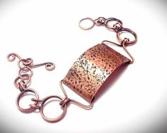 Copper chain linked bracelet with textured focal