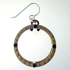 Daniel Kamman, Industrial Jewelry  Thrust ball bearings separated by sterling silver tubes fastened by black camera screws - Daniel Kamman industrial earrings
