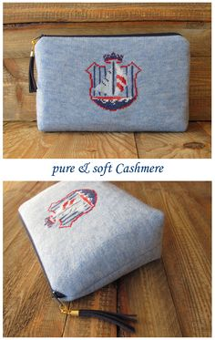 small pouch made of cashmere with handembroidered marine emblem luxurious makeup bag yacht habour sailing boat blue white red leather tassel